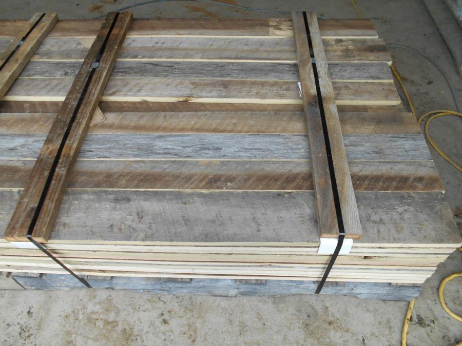 Reclaimed lumber with brown & gray boards, straight line ripped