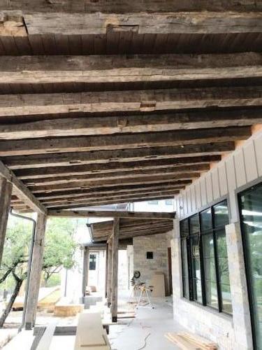 Reclaimed Hand Hewn Hardwood roof beams!